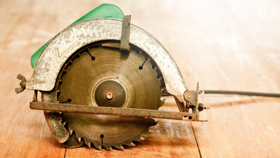 Old circular saw on the table.