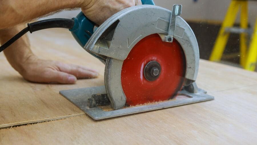 Using Circular saw to cut plywood.