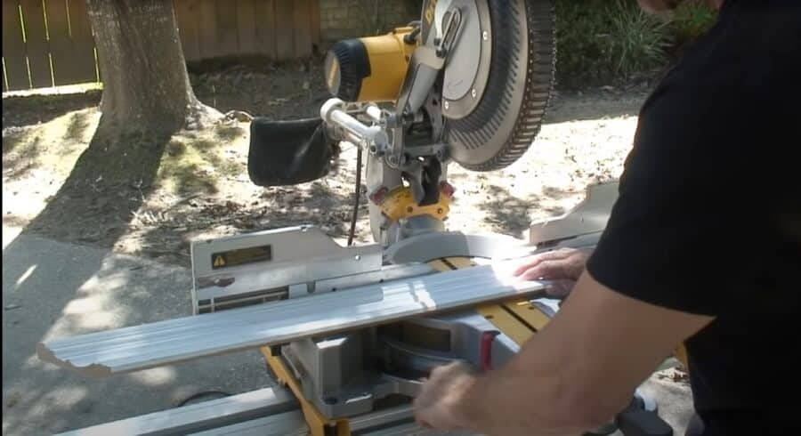 Cutting flat crown molding with miter saw.
