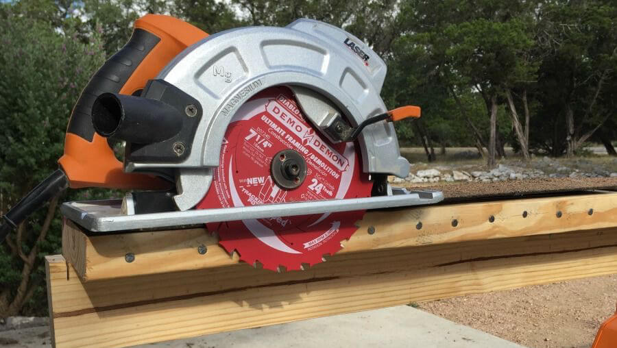 Using demolition blade to cut through wood full of nails.