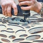 Cut inner curve motif on wood.