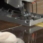 Cutting Plexiglass sheet with jigsaw blade.