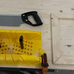 Using miter box and hand saw to cut 45 and 90 degree angles.