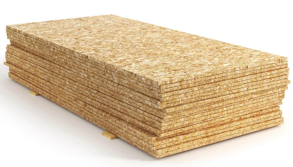 Stack of wood particle board stored in the warehouse.