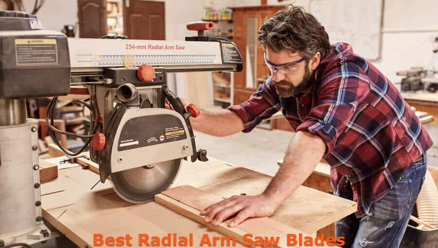 Carpenter using the suitable blade for the radial arm saw in workshop.
