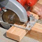 Use circular saw to cut 2x4 wood.