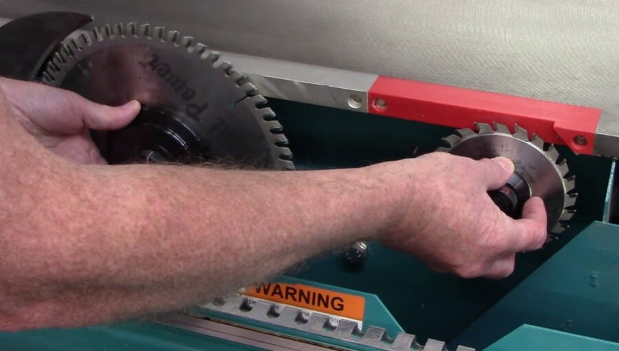 Setting up and adjusting the scoring blade on table saw.