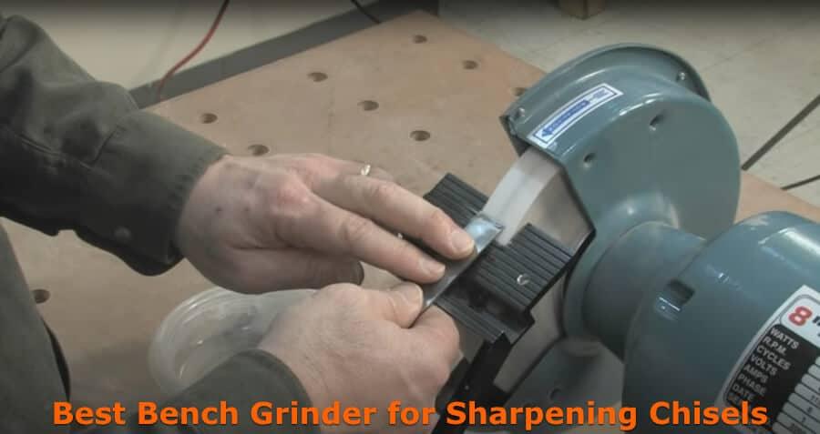 Sharpening edge of chisels using grinder.