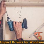 Use impact driver to install wood cabinet drawer.