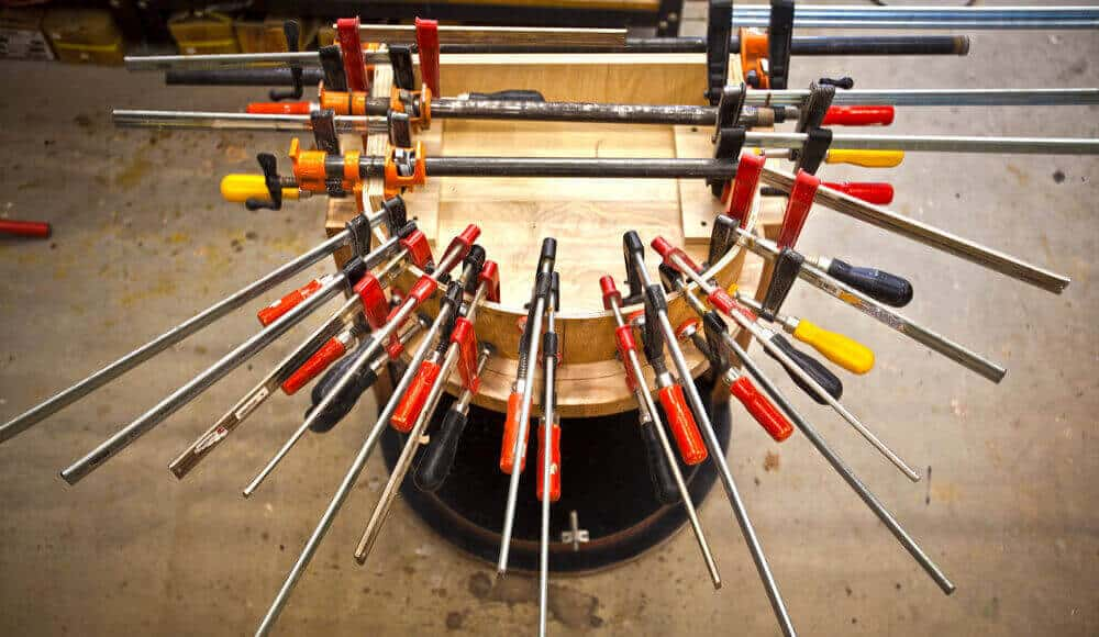 various sizes and models of woodworking clamps.
