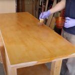 Apply finish coating on the woodworking workbench.